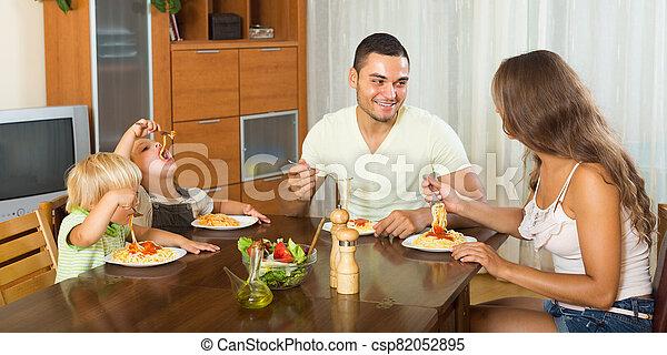 Family eating spaghetti - csp82052895
