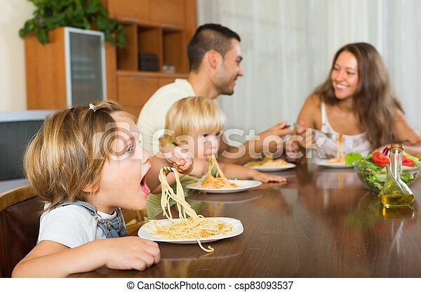 Family eating spaghetti - csp83093537