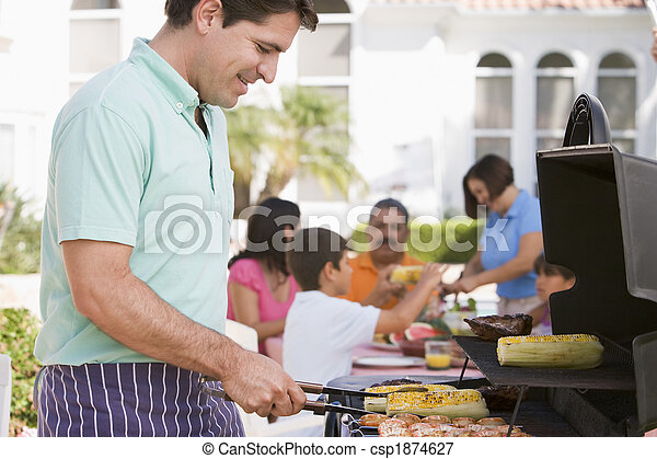 Family Enjoying A Barbeque - csp1874627