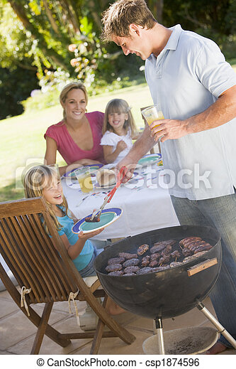 Family Enjoying A Barbeque - csp1874596
