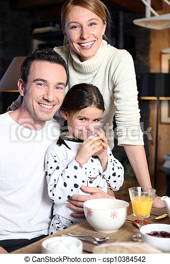Family enjoying breakfast together - csp10384542