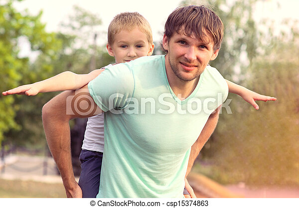 Family Father Man and Son Boy Child with raised hands playing Outdoor park Happiness emotion with summer nature on background - csp15374863
