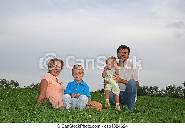 family four on meadow - csp1824624