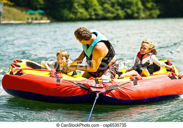 Family Fun Tubing on a Lake - csp6530735