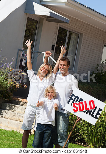 Family happy to have bought a home - csp1861348