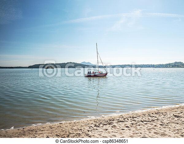Family has fun in yacht sailing on lake during season - csp86348651