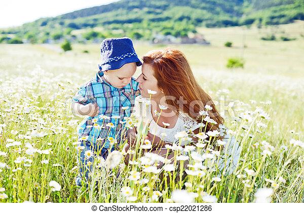 family having fun in field - csp22021286