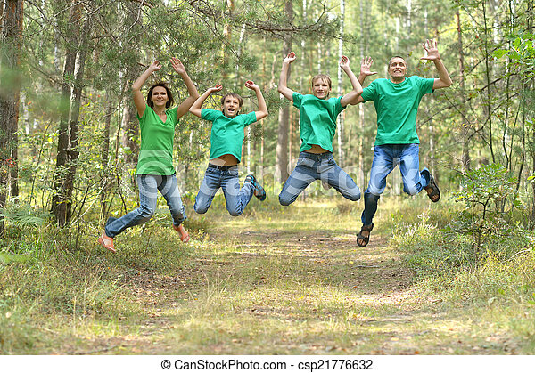 Family having fun in park - csp21776632