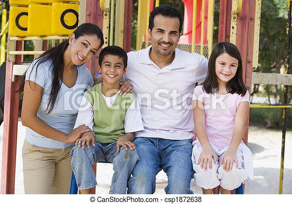 Family having fun in playground - csp1872638