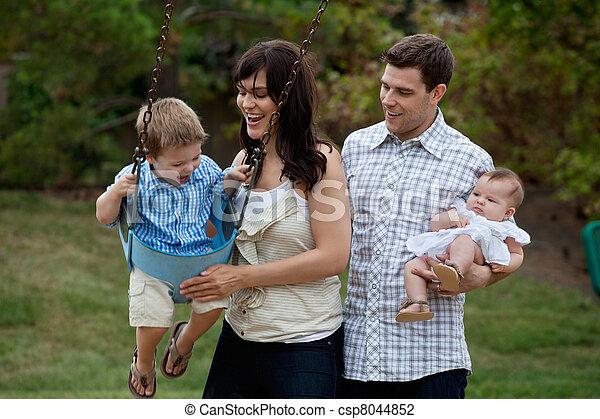 Family Having Fun in Playground - csp8044852