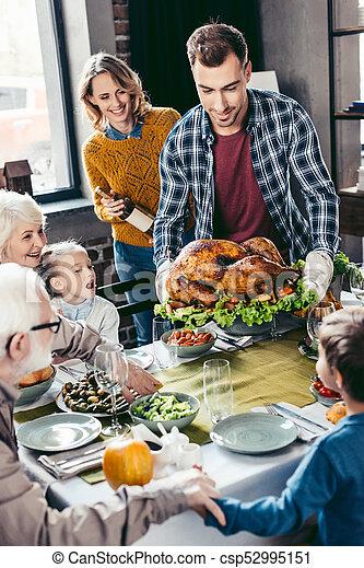 family having holiday dinner - csp52995151