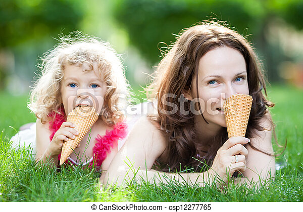 Family having picnic outdoors - csp12277765