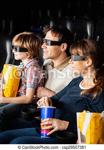 Family Having Snacks While Watching 3D Movie - csp29507381
