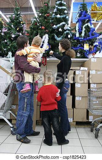 family in christmas shop - csp1825423