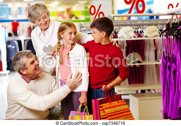 Family in department store - csp7346716