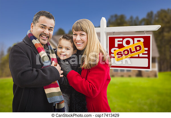 Family in Front of Sold Real Estate Sign and House - csp17413429