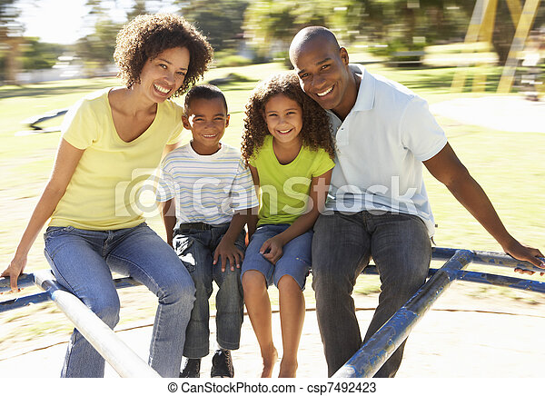 Family In Park Riding On Roundabout - csp7492423