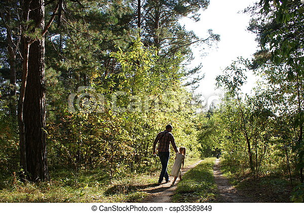 Dad with daughter walking