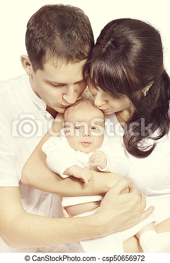 Family kiss newborn baby mother and father kissing new born child kid one month