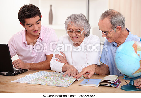 Family looking at a map - csp8895452