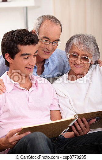 Family looking at a photo album - csp8770235