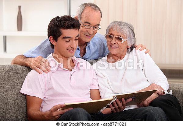 Family looking through photo album - csp8771021
