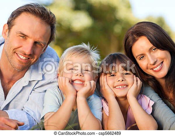 Family lying down in the park - csp5662489