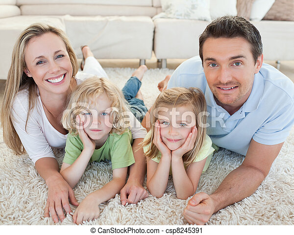 Family lying on the carpet - csp8245391