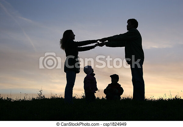 family of four on sunset sky - csp1824949