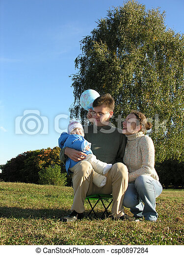 family of three on meadow - csp0897284