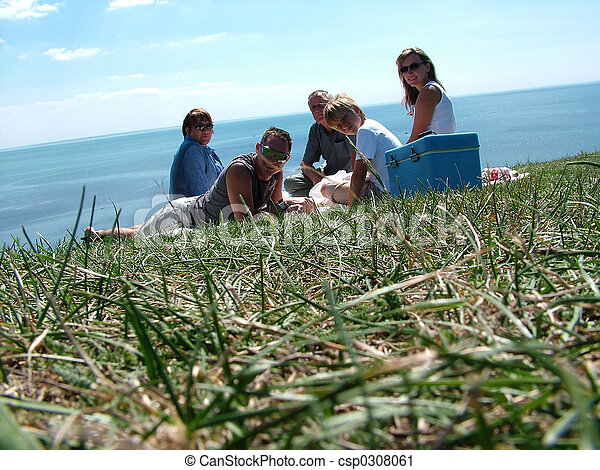 Family on a grass under the blue sky  - csp0308061