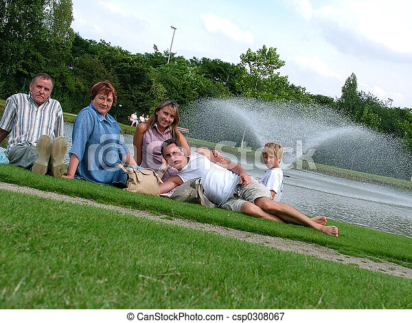 Family on a grass under the blue sky  - csp0308067