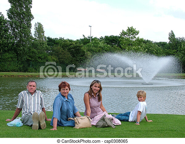 Family on a grass under the blue sky  - csp0308065