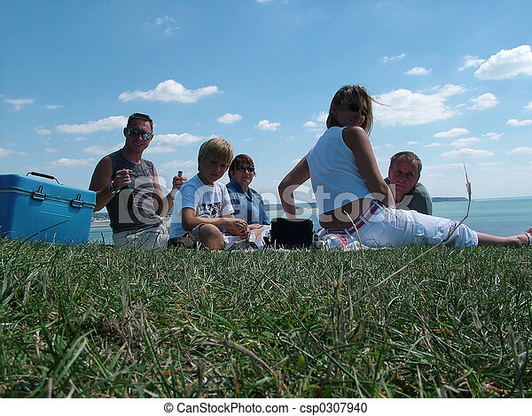 Family on a grass under the blue sky  - csp0307940