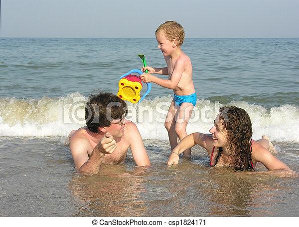 family on beach - csp1824171
