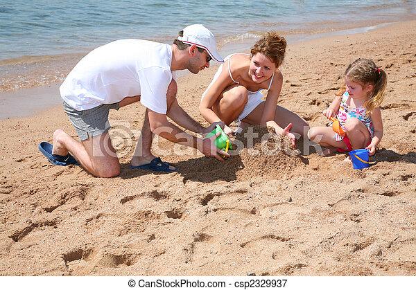 family on beach - csp2329937