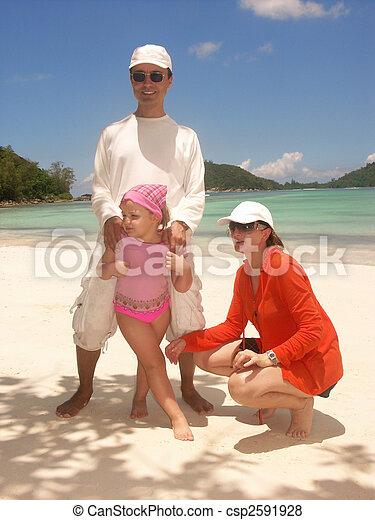 family on beach - csp2591928