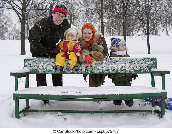 family on bench - csp0575787