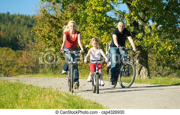 Family on bikes - csp4326930