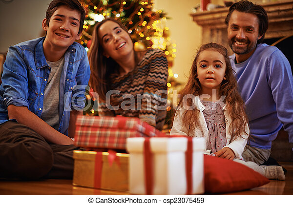 Family on Christmas eve - csp23075459