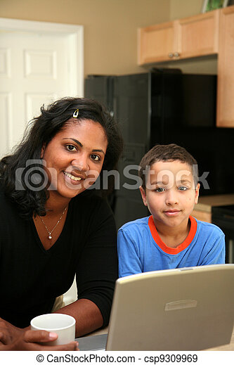 Family on Computer - csp9309969