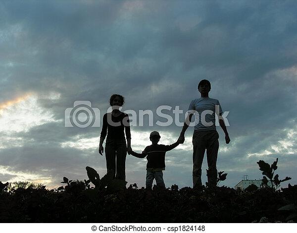 family on evening sky - csp1824148