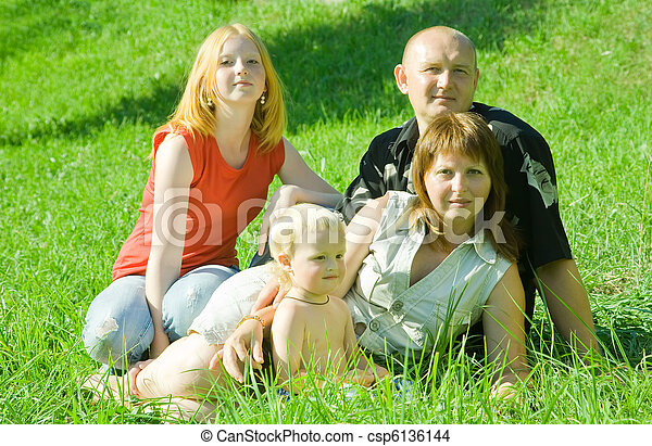 family on grass - csp6136144