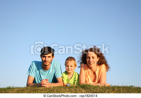 Family on herb under blue sky lie - csp1824514