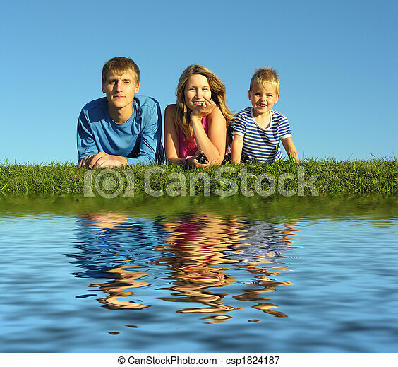 family on herb under blue sky - csp1824187
