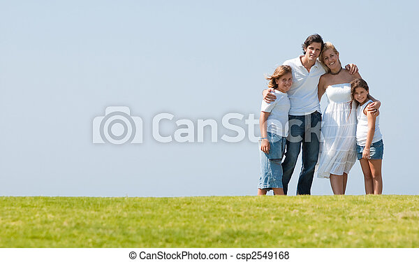 Family on herb under blue sky - csp2549168