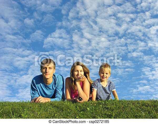 family on herb under blue sky - csp0272185