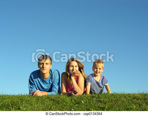 family on herb under blue sky - csp0134364