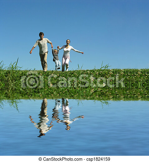 family on herb under blue sky - csp1824159