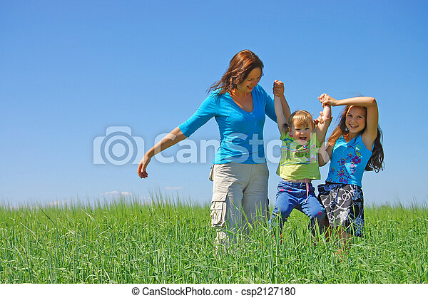 family on herb under blue sky - csp2127180